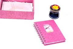 Pink book note and paper box. On isolate stock photos