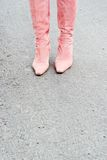 Pink boots. Pink suede boots on pavement Royalty Free Stock Images