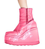 Pink boots isolated on white. Background stock photo