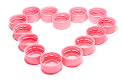 Pink bottle caps Royalty Free Stock Image