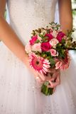 Pink Bouquet. A bride holding her pink flower bouquet Royalty Free Stock Photography