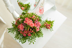 Pink bouquet of flowers on a table. Pink bouquet of flowers on a white table Stock Image