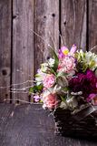 Pink bouquet from gillyflowers and alstroemeria in the basket on Stock Photography