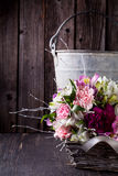 Pink bouquet from gillyflowers and alstroemeria in the basket on Royalty Free Stock Image