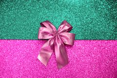 Pink bow on a color sparkling background stock photos