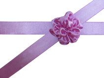 Pink bow-flower on the crossed ribbon. Pink satin bow-flower on the crossed satin pink ribbons Stock Images