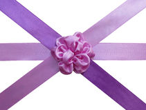 Pink bow-flower on the crossed ribbons. Pink bow-flower on the crossed violet and pink satin ribbons Stock Images