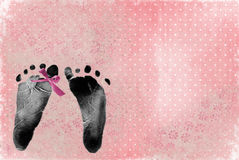 Pink bow on footprint Stock Photos