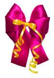 Pink bow with golden ribbon made from silk Royalty Free Stock Photo