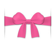 Pink bow. Inserted into cuts in a background Stock Image