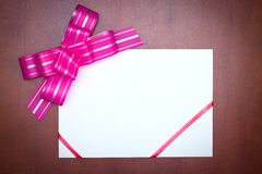 Pink bow with paper card Royalty Free Stock Photography