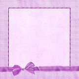 Pink bow on plaid border Royalty Free Stock Photo
