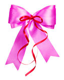 Pink bow with red ribbon made from silk Stock Photography