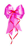 Pink bow with red ribbon made from silk Royalty Free Stock Photos