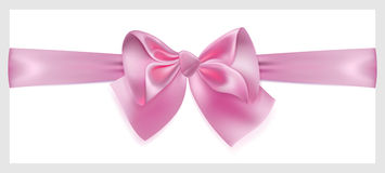 Pink bow with ribbon, located horizontally Stock Images