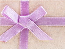 Pink bow on shining paper gift box Stock Photo