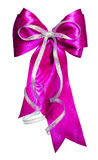 Pink bow with silver ribbon made from silk Stock Photography