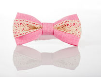 Pink bow tie with white lace Royalty Free Stock Image
