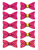 Pink bow tie with yellow dots set realistic vector illustration. Isolated on white background Royalty Free Stock Photos