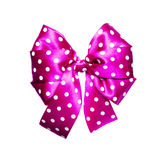 Pink bow with white polka dots made from silk Royalty Free Stock Photography