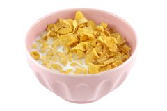 A pink bowl of cereal, corn flakes and fresh milk. A pink bowl of cereal, corn flakes and fresh low fat milk isolated on white background Royalty Free Stock Photography