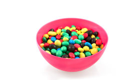 Pink bowl with chocolate candy bowls Stock Images