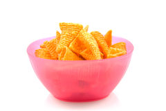 Pink bowl filled with potato chips Royalty Free Stock Photo