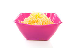 Pink bowl with grated cheese Stock Photos