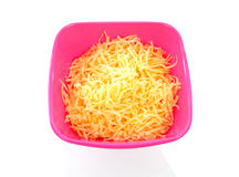 Pink bowl with grated cheese Royalty Free Stock Photography