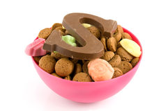 Pink bowl with pepernoten and candy Stock Photography