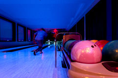 A Pink Bowling balls has ready for player to throwing ball. On the wooden lane and in the bowling hall stock photography