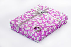 Pink box with bow and diamond ring Stock Image