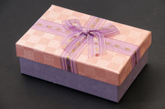 Pink box with a bruise on a black background Stock Image