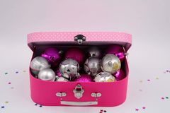 Pink box full of Christmas ornaments stock photography