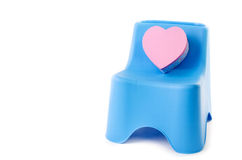 Pink box heart with plastic chair isolated on white Stock Image