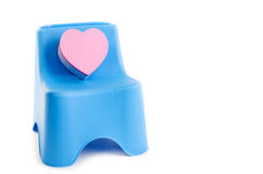 Pink box heart with plastic chair isolated on white Stock Images