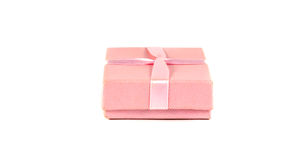 Pink box with a ribbon. On a white background Royalty Free Stock Photos