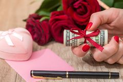 Pink box, roses money. Pink box, roses, money on the table Royalty Free Stock Photography