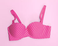 Pink bra with many heart shapes on pink background Stock Photos