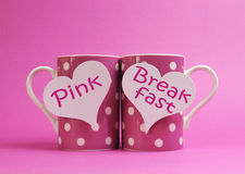 Pink Breakfast message written on two pink polka dot coffee mugs Royalty Free Stock Image