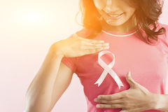 Pink breast cancer awareness ribbon. Healthcare and medicine concept - woman with pink breast cancer awareness ribbon Stock Images
