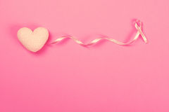 Pink Breast Cancer Ribbon with decoration pink heart . Pink Breast Cancer Ribbon with a decoration pink heart Stock Images
