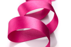 Pink breast cancer ribbon. Isolated on white background