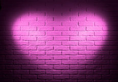 Pink brick wall with heart shape light effect and shadow, abstract background photo Royalty Free Stock Image