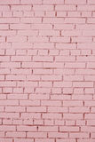 Pink brick wall with shabby paint Stock Photos