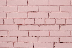 Pink brick wall with shabby paint Royalty Free Stock Photos