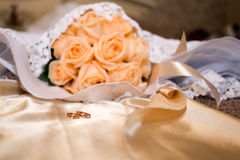 Pink bridal bouquet on the dress Royalty Free Stock Image