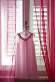 Pink bridesmaid's dress Stock Photography