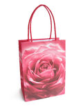 Pink brightly colored shopping bag isolated over a white backgro. Und Stock Photo