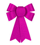Pink brilliant gift bow with glitter close-up isolated on a white background. Stock Photos